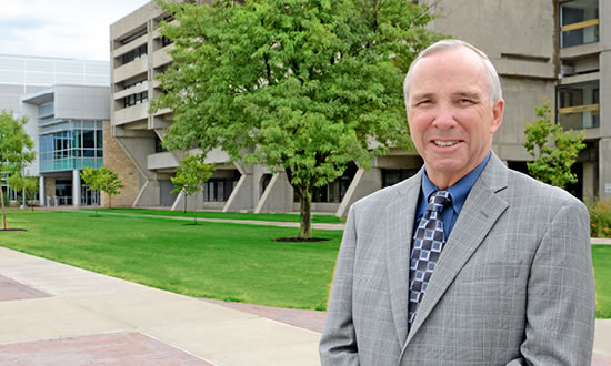 FLCC President Robert Nye in front of main campus