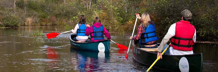 Students in canoes paddling at the Muller Field Station