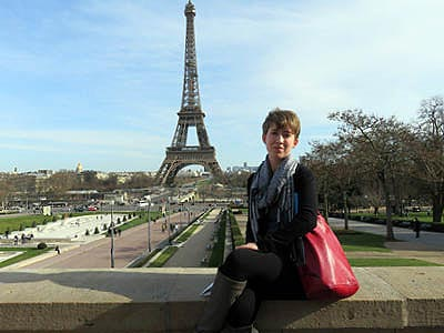Student in Paris, France with the Eiffel Tower in the background